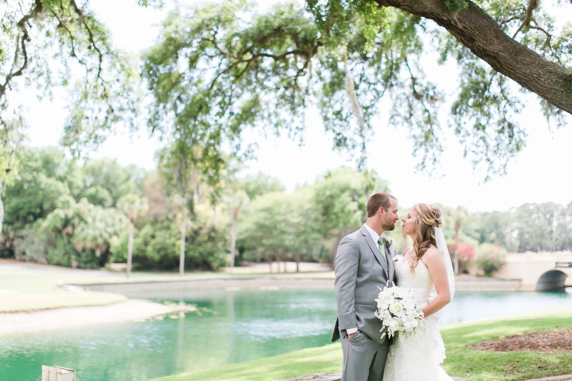 Mission Inn - bride and groom under oak tree