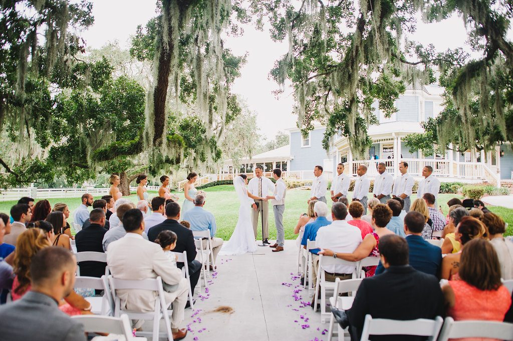 Press Play Entertainment - bride and groom outdoor ceremony under oak tree