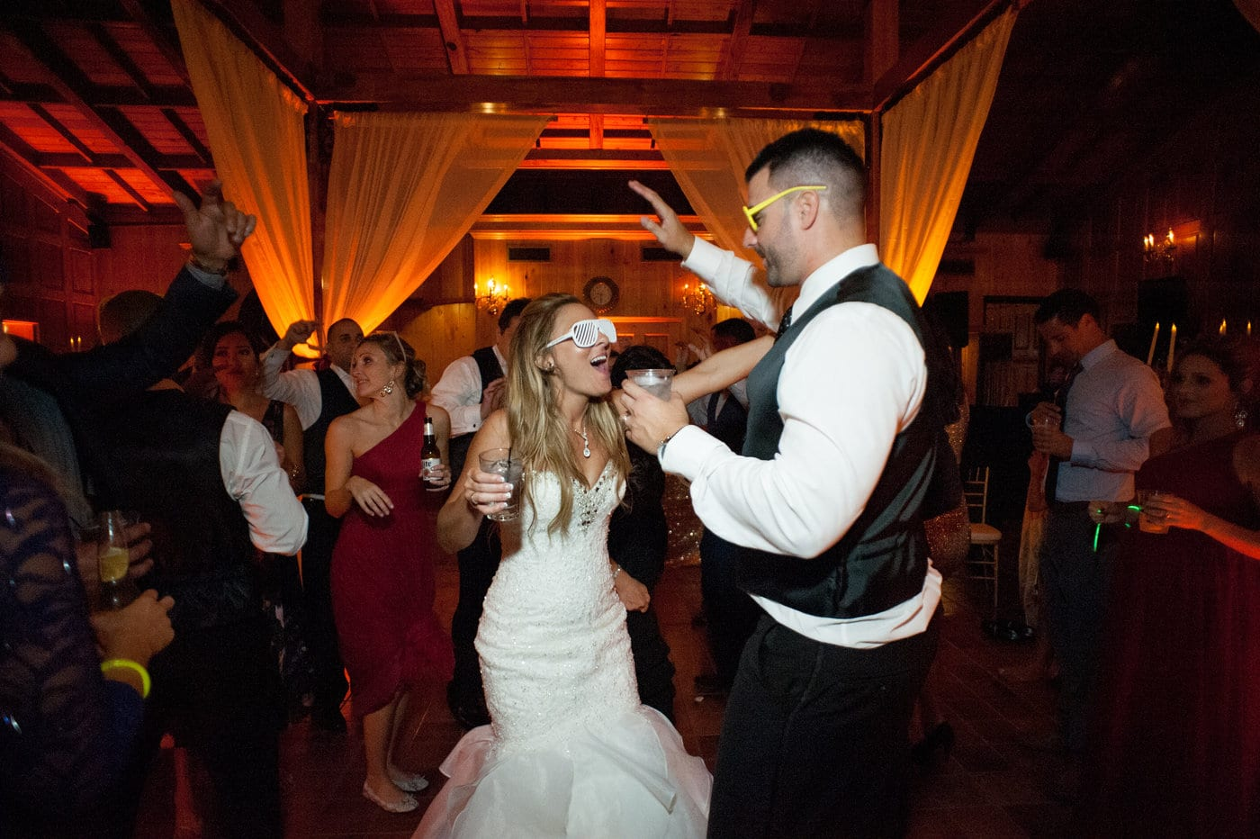 Press Play Entertainment - bride and groom with drinks and sunglasses on dance floor