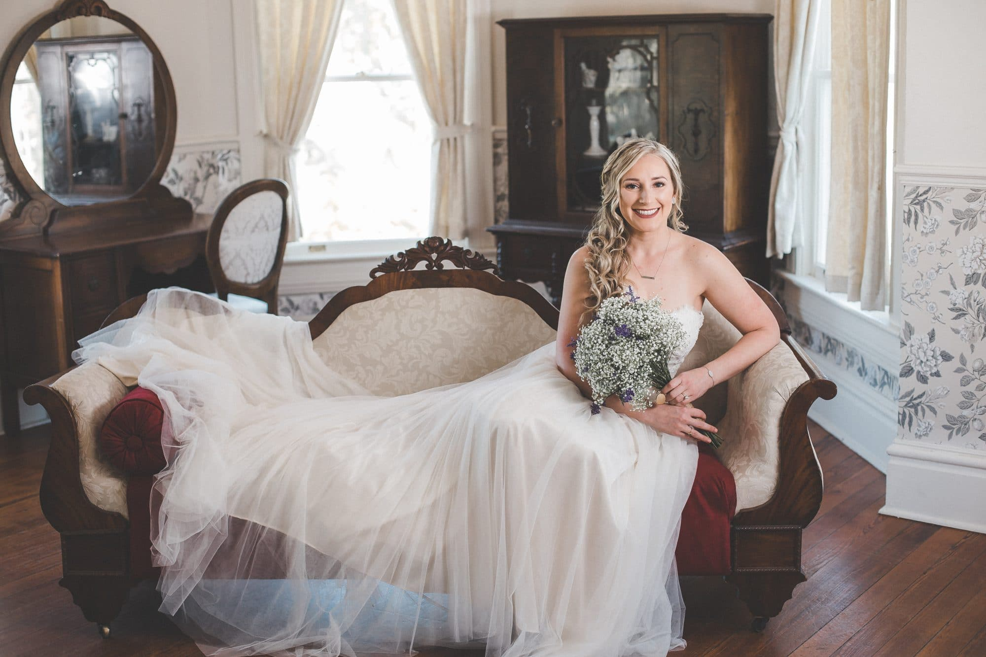 Rachel Doyle Photography - bride on couch in ready room