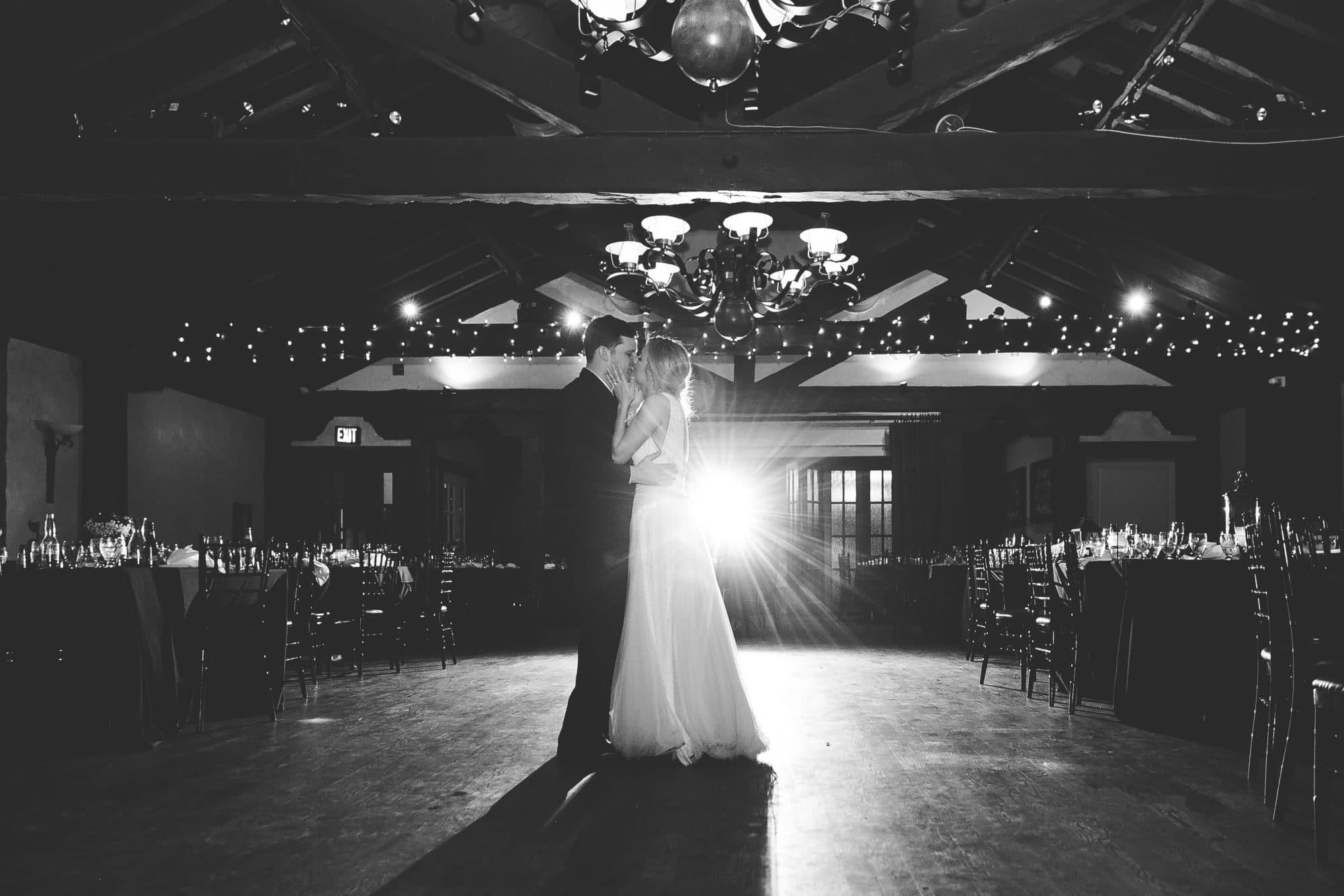Rachel Doyle Photography - bride and groom slow dancing in empty reception room