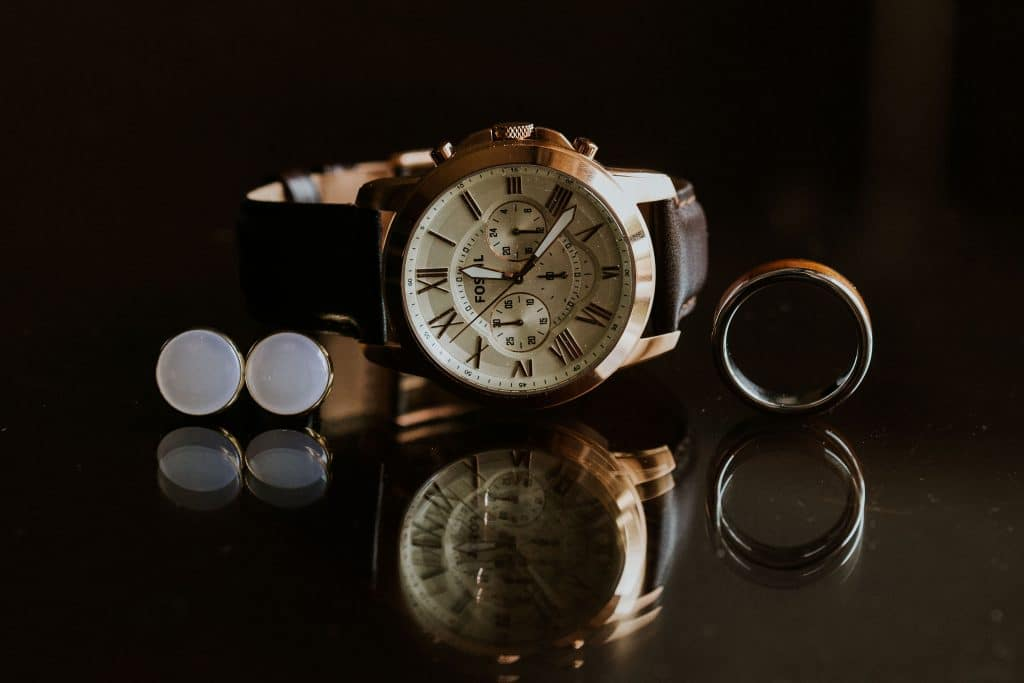 Rachel Doyle Photography - close up of groom's cufflinks, watch, and ring