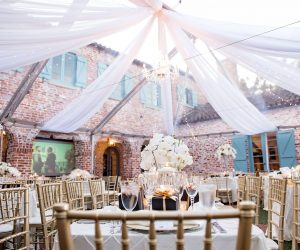 Rentaland Tents and Events - white ceiling draped over reception tables
