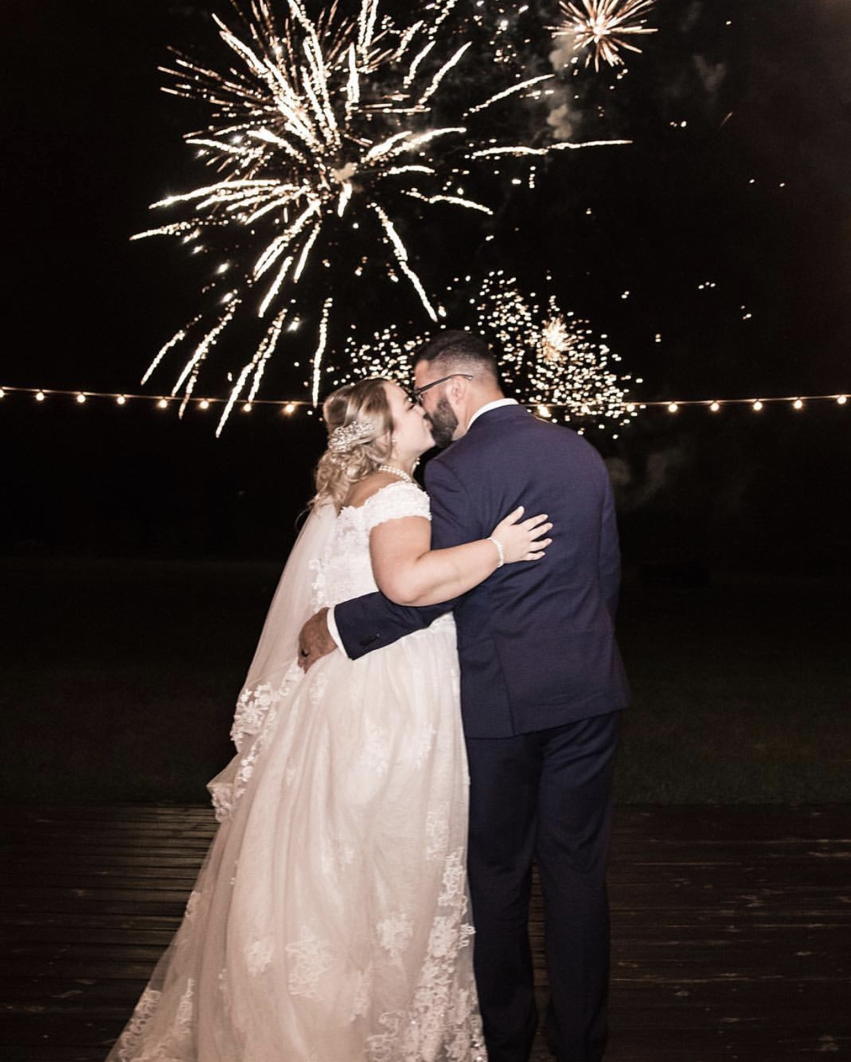 The Enchanting Barn - couple kissing with fireworks in background