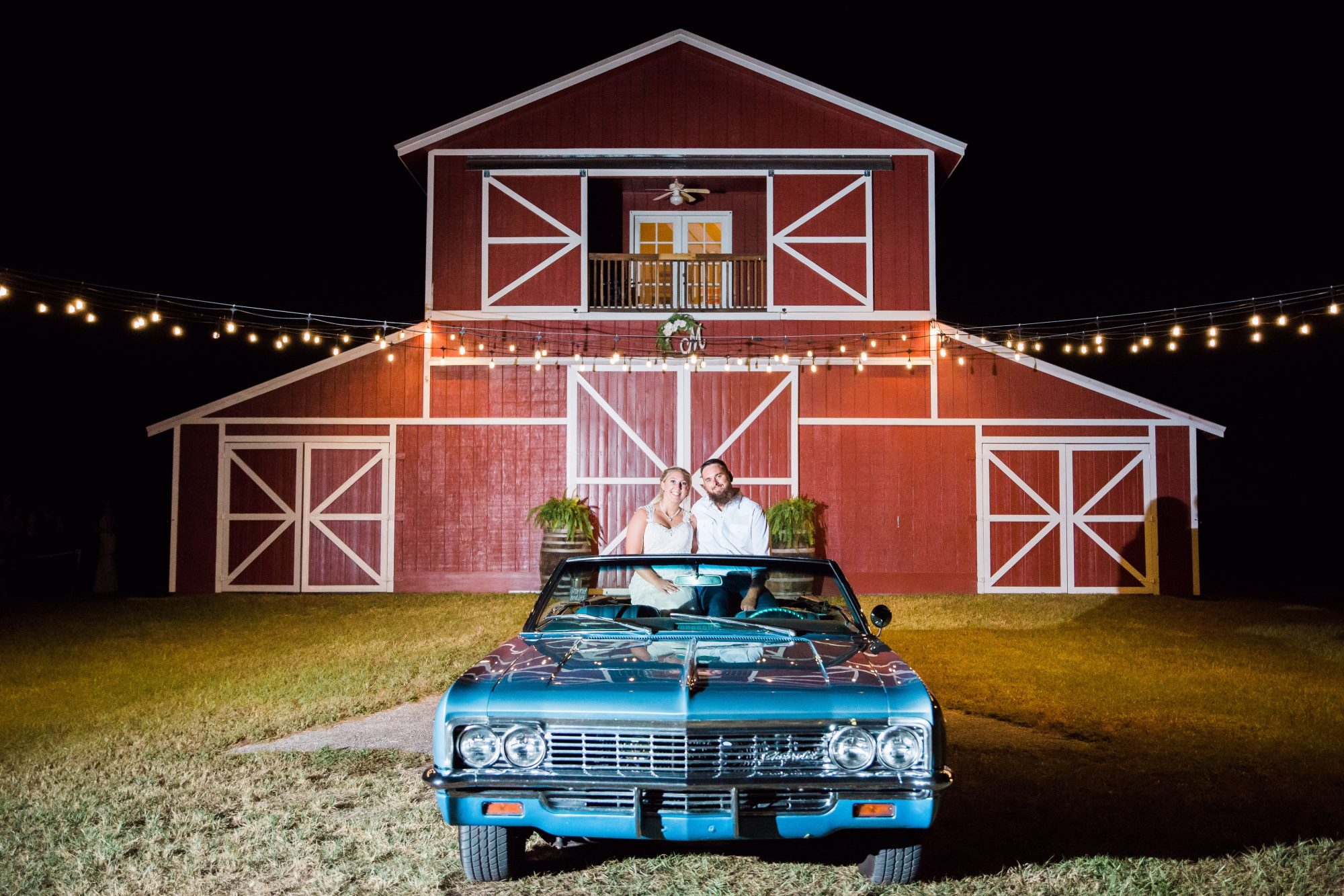 The Red Barn at Bushnell - couple in classic car outside of red barn wedding venue