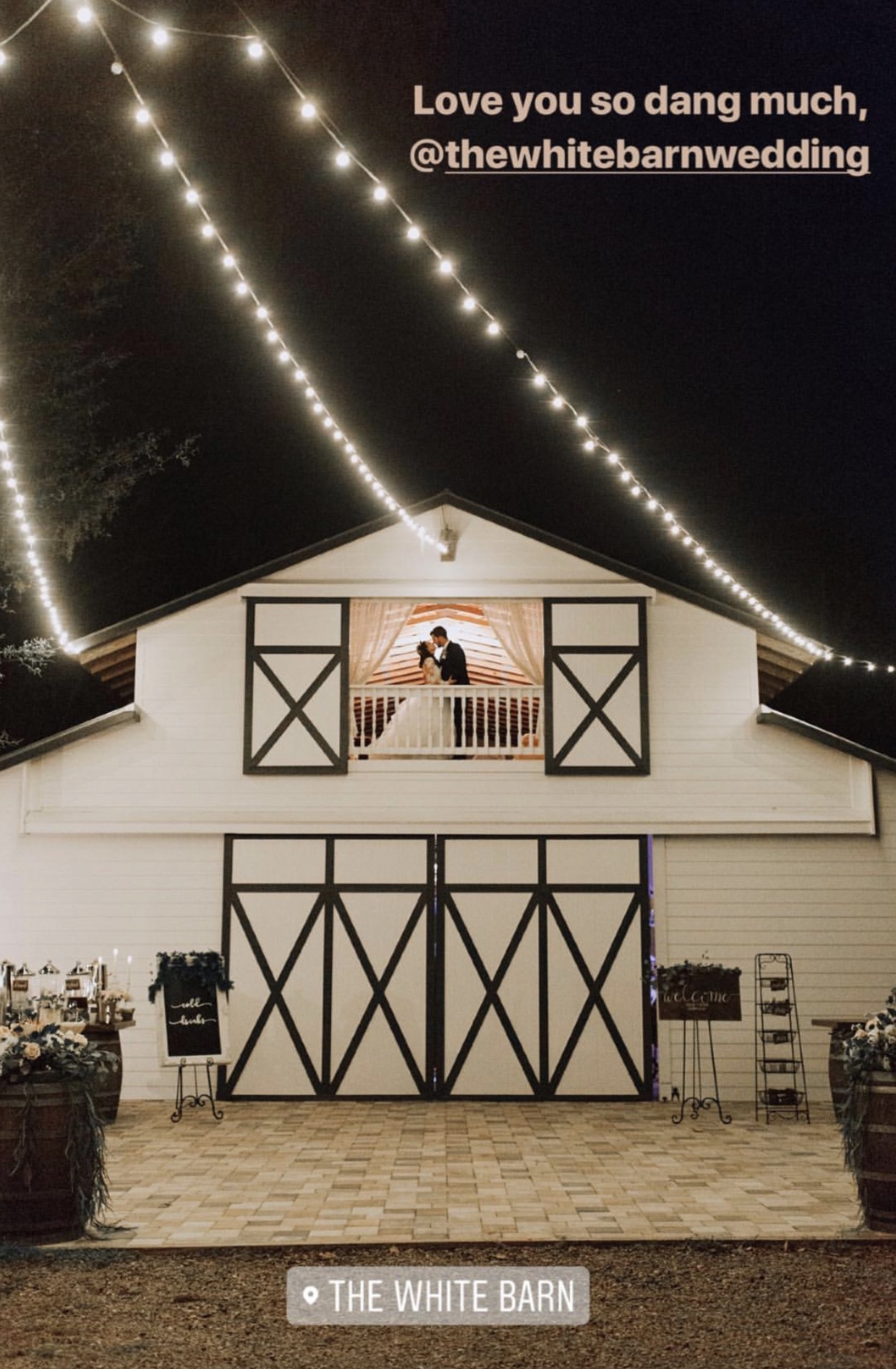 The White Barn - cute white barn venue with black details