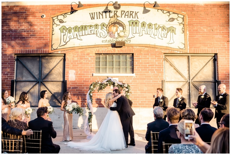 Winter Park Farmer's Market - wedding ceremony in front of brick building