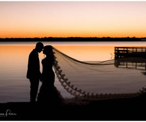 Chynna Pacheco Photography - silhouette of bride and groom at sunset by the lake