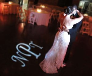 Classic Disc Jockeys - bride and groom dancing next to projected monogram on floor