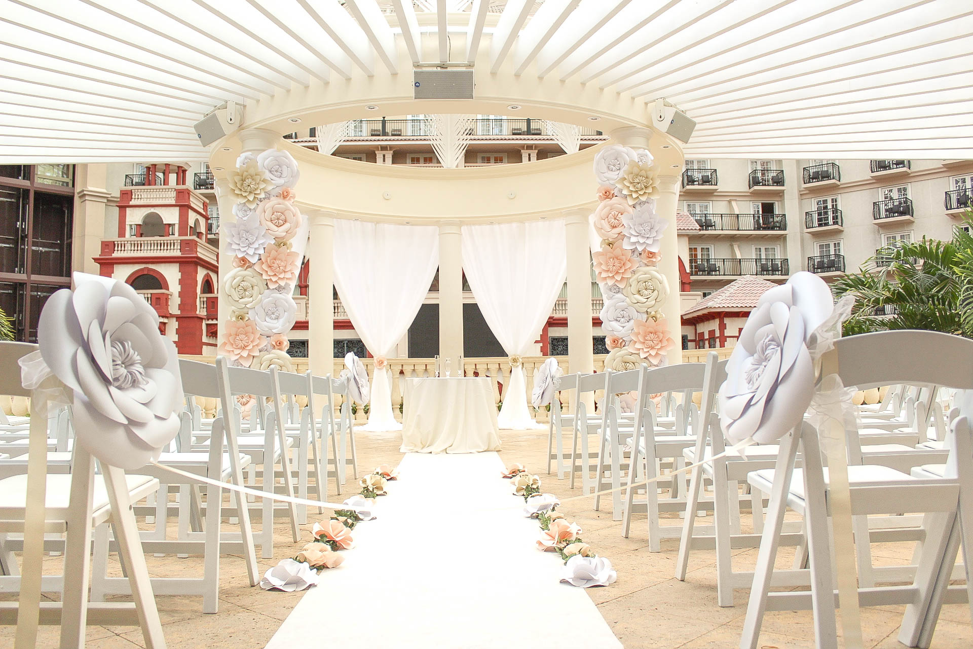 Dazzling Deco - ceremony set up with paper flower decorations