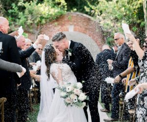 For the Love of Events - bride and groom kissing with confetti