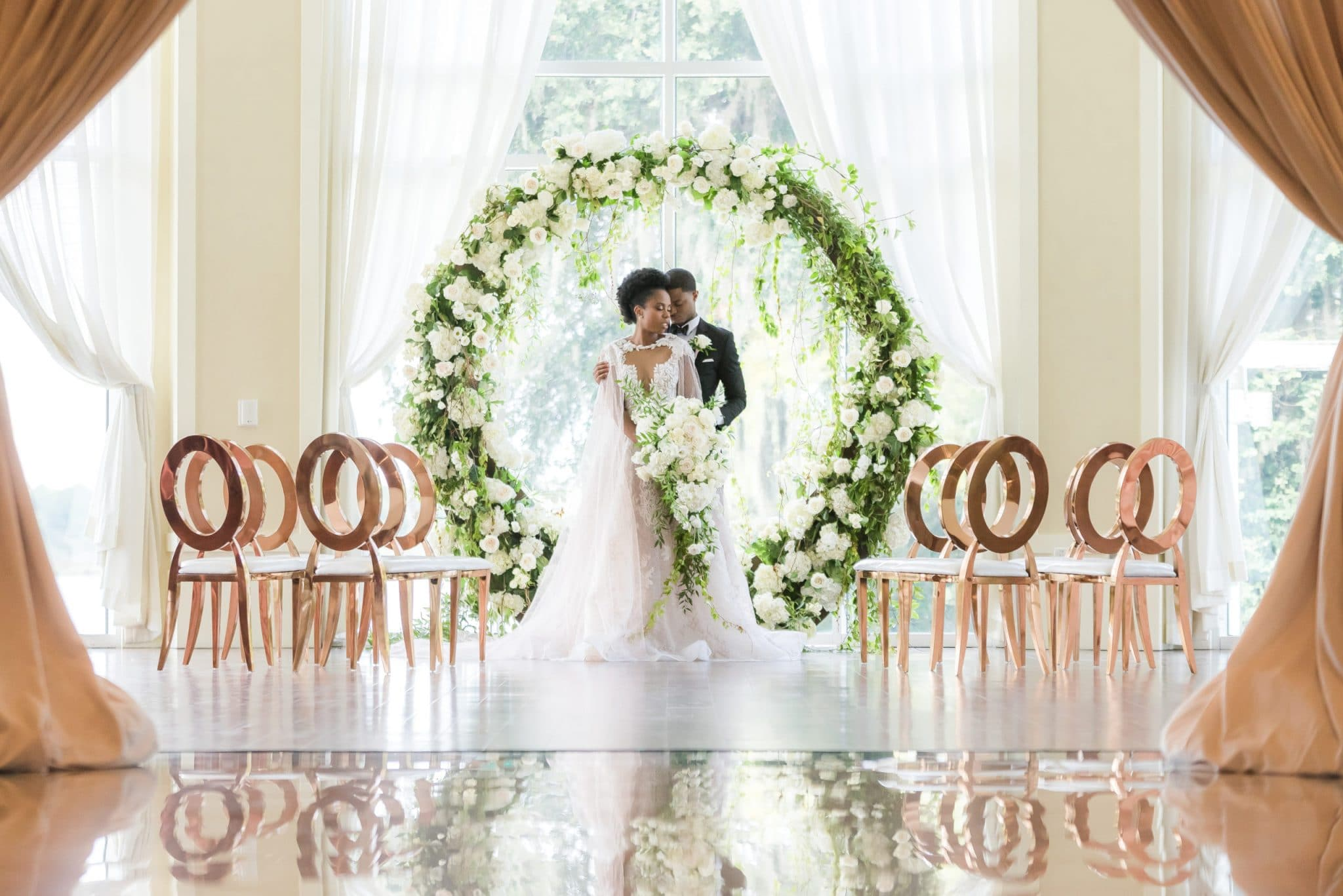 Orlando Wedding and Party Rentals, bride and groom standing in front of flower ring at ceremony