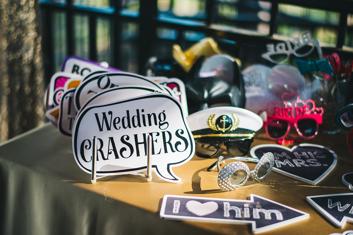 table full of fun photo booth props