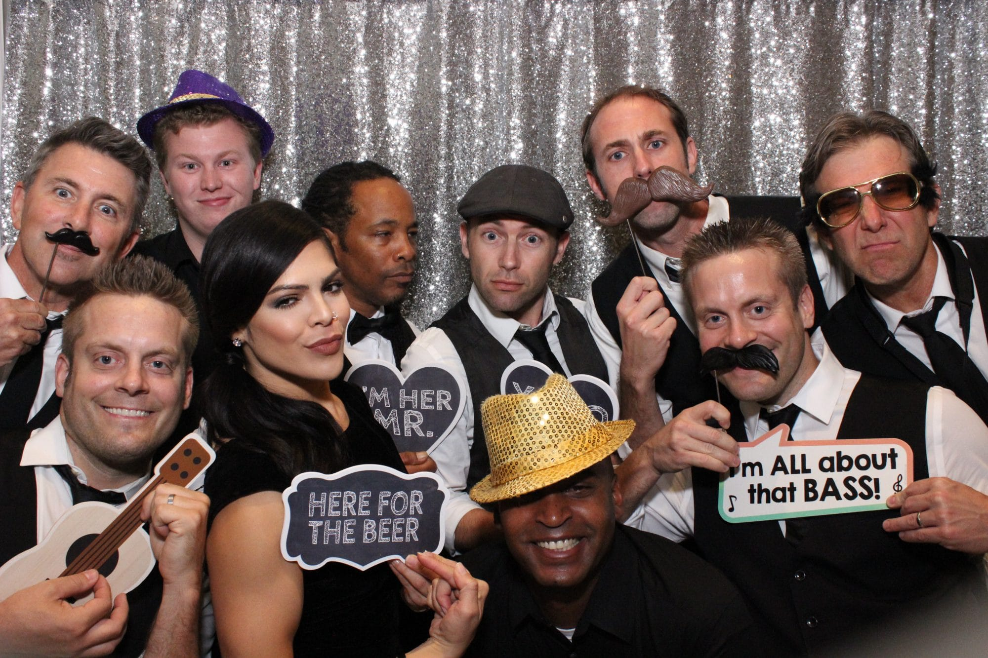 group of guests with props in a photo booth