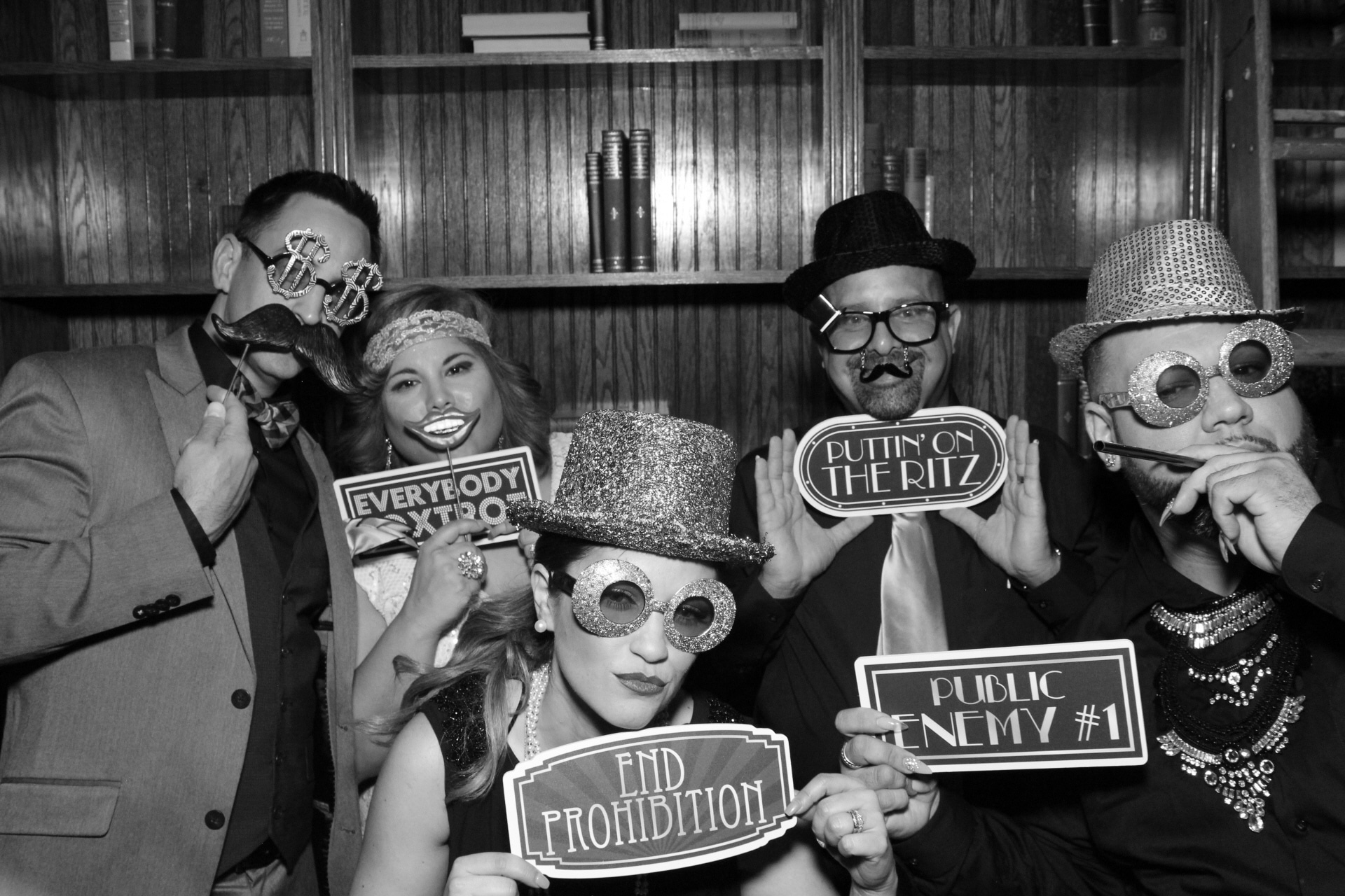 black and white photo booth picture with Gatsby themed props