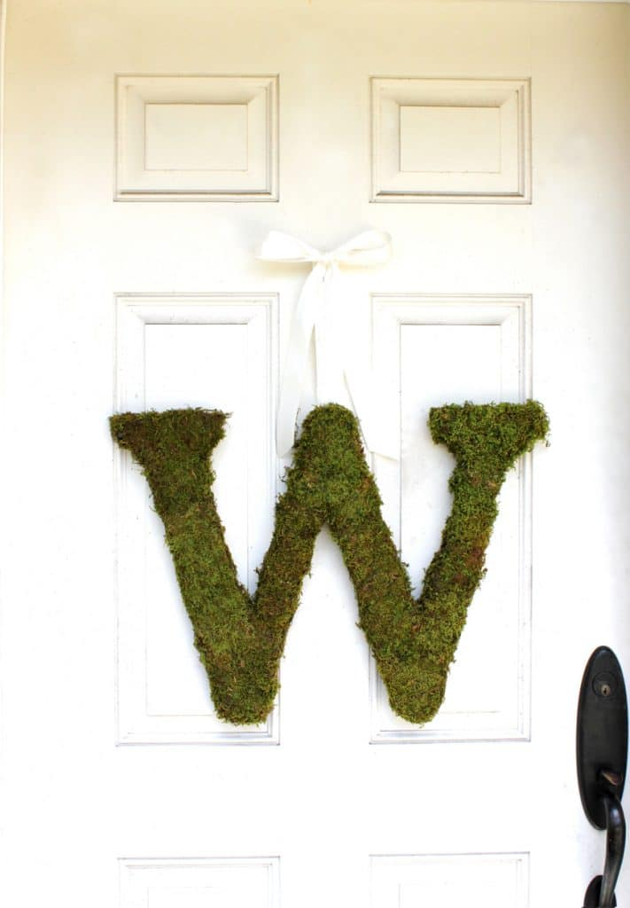 The Magnolia Company - large, moss-covered initial hanging on door