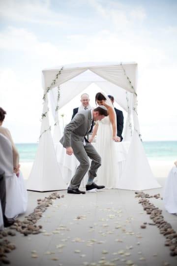 Jewish groom stomping on glass