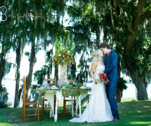 Embrace by Kara - bride and groom next to romantic outdoor sweetheart table