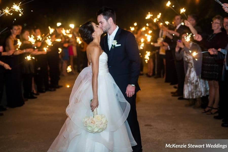 Estate on the Halifax - Bride and Groom kiss during evening send off with wedding guests and sparklers