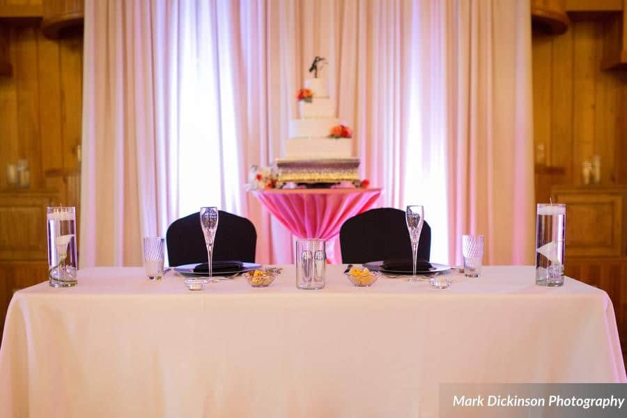 Estate on the Halifax - Bride and Groom table setting with four tier cake in background