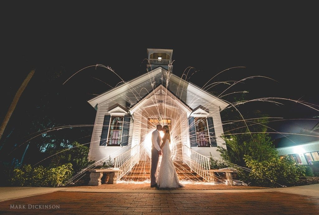 Estate on the Halifax - Bride and Groom kissing in front of Church with spiral sparkler in background