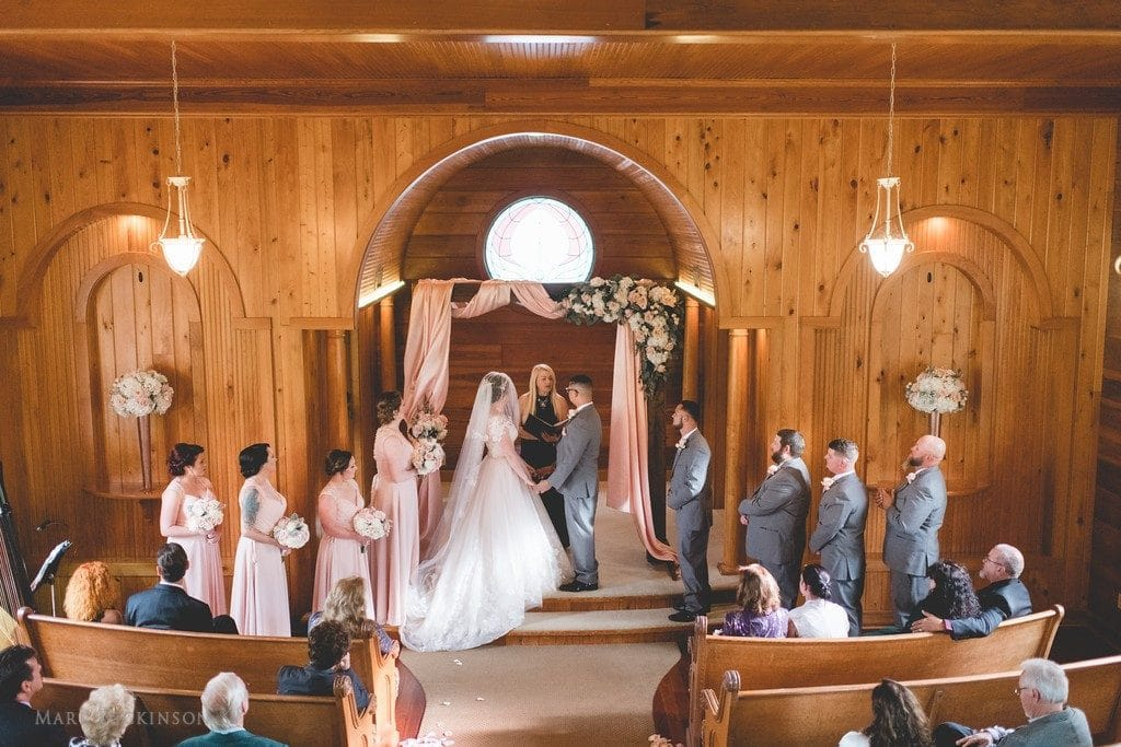 Estate on the Halifax - Bridal party during wedding ceremony indoors wooden church walls