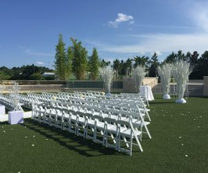 I Rent Everything - rows of folding chairs and tree sculptures for ceremony