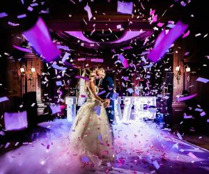 iRock Your Party - bride and groom kissing on dance floor in shower of confetti