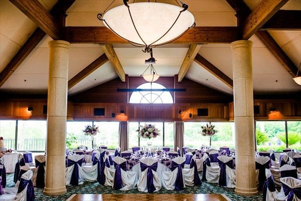 Sugar-Mill-Country-Club-Indoor recpetion area with different table configuration with large windows