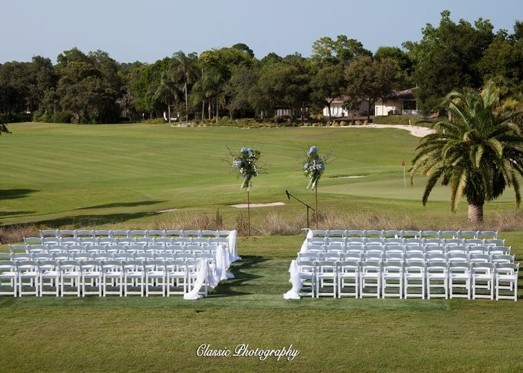 Sugar-Mill-Country-Club-Chairs set up for ceremony overlooking golf course