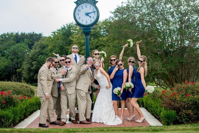 Sugar-Mill-Country-Club-Bridal party having fun in front of the clock tower with groomsmen