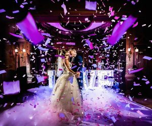 IRock Your Party - bride and groom kiss under confetti