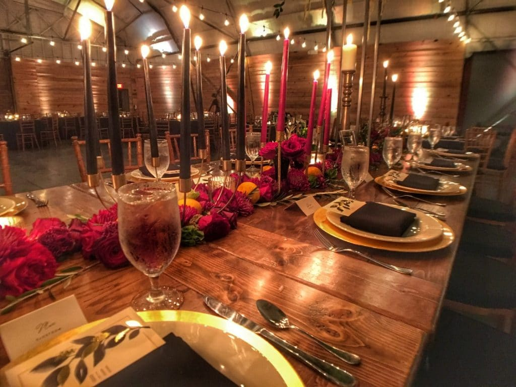 1010-West-Large table setting with tall candle centerpieces