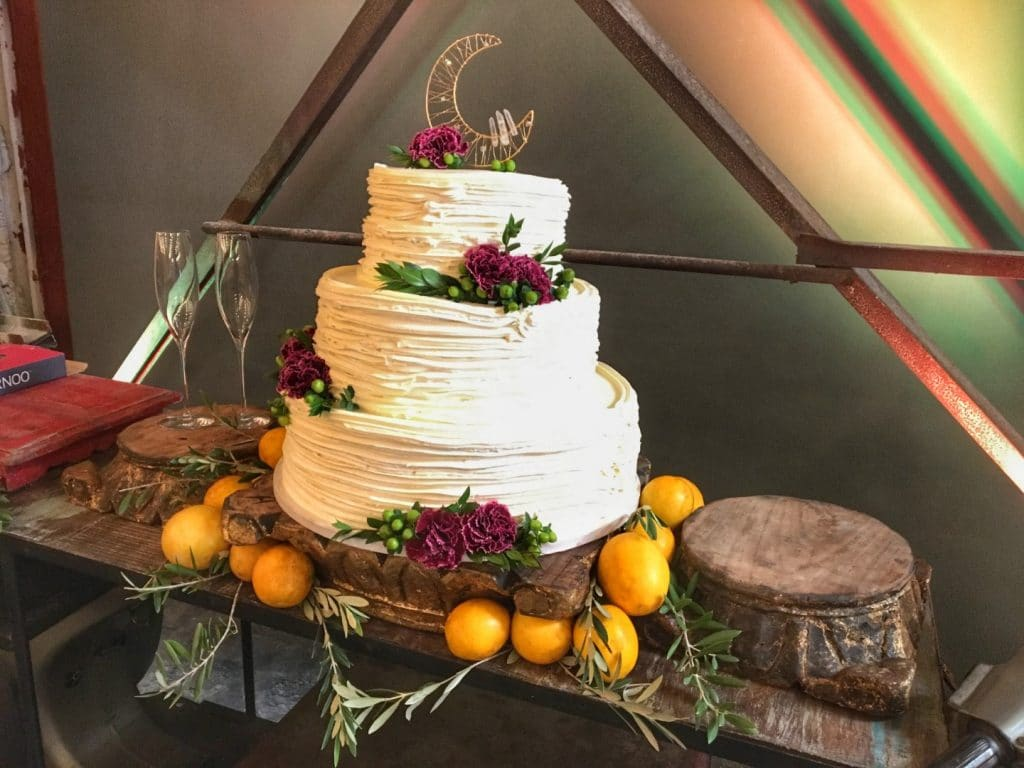 1010-West-Rustic three tier white cake with dark roses as decoration