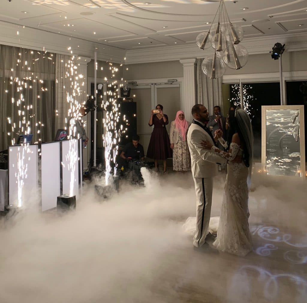 bride and groom first dance with indoor fireworks