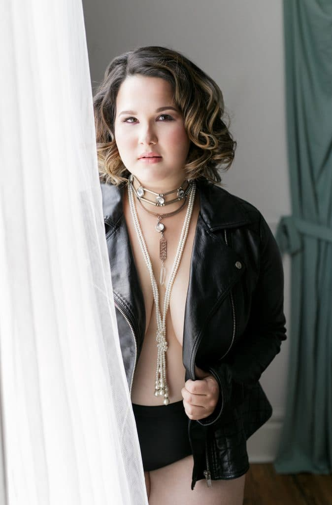 bb by Bumby - boudoir shoot with woman wearing leather jacket and long necklaces