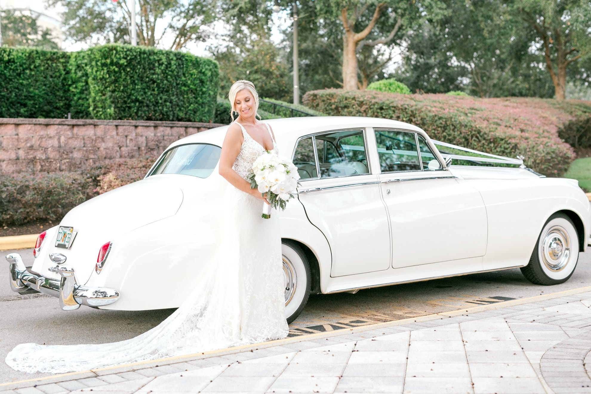 Bumby Photography - bride posing next to white classic car