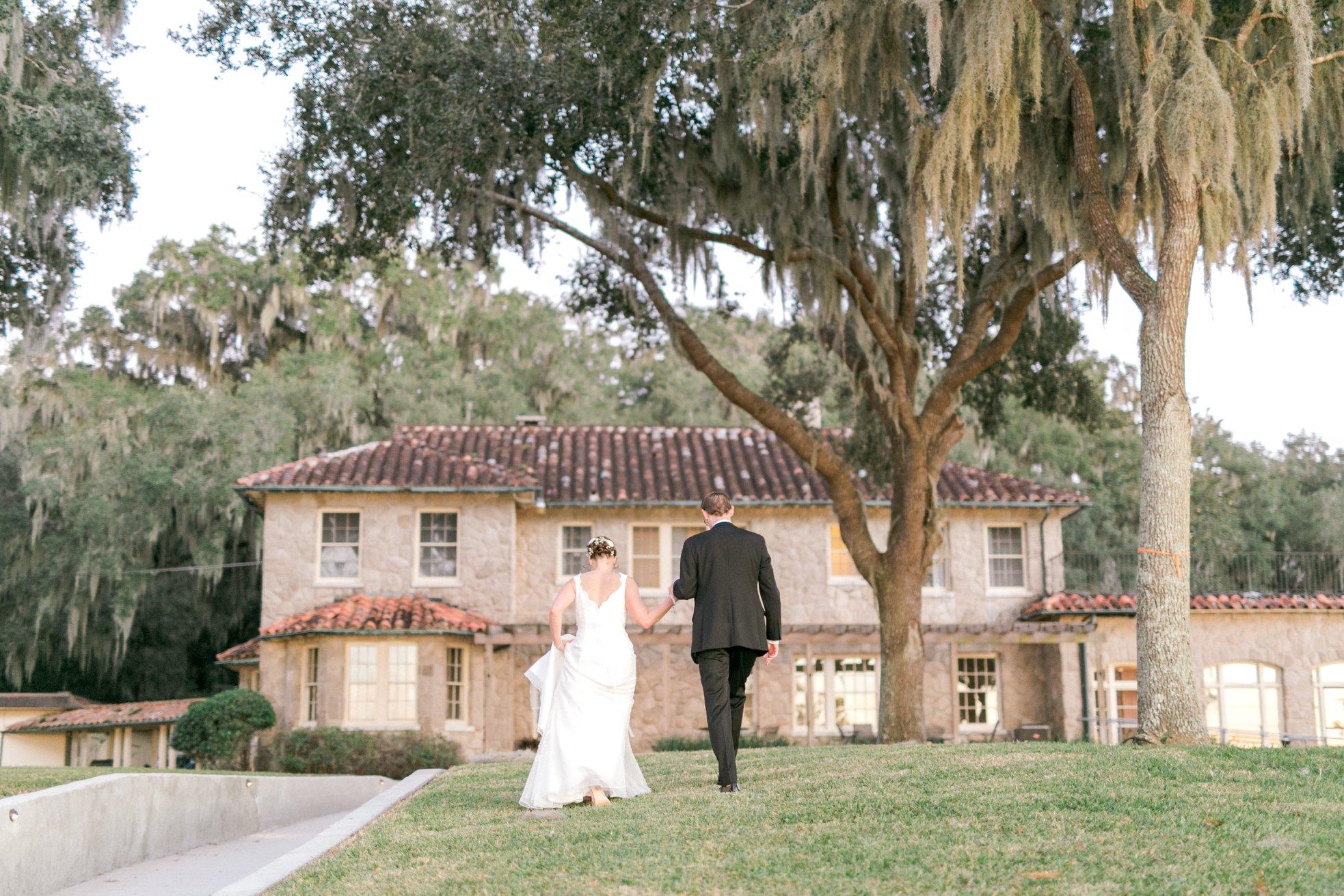 Bumby Photography - bride and groom walking toward Italian villa