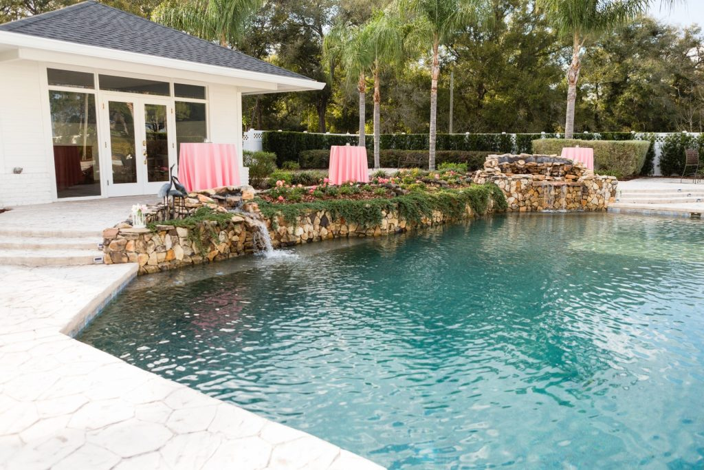 C-Squared-Events-LLC-Pink table surrounding outdoor pool