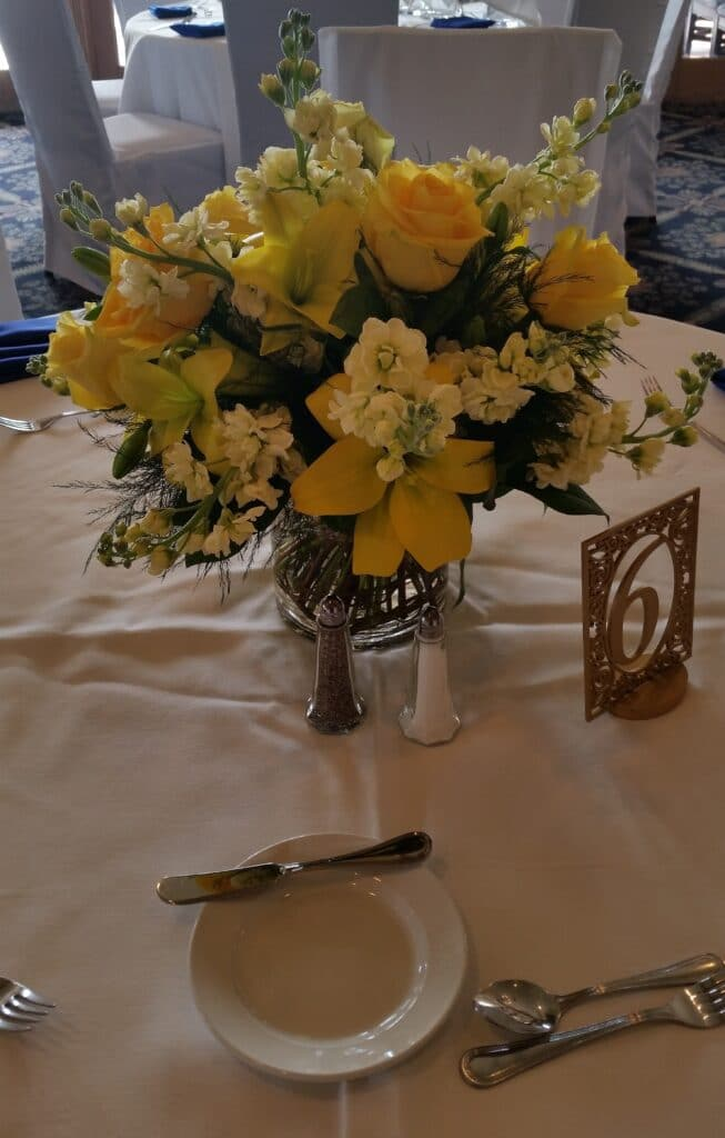 yellow flower centerpiece for wedding reception dinner table