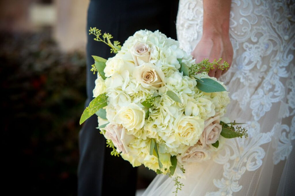 bride holding beautiful flower bouquet for her wedding day