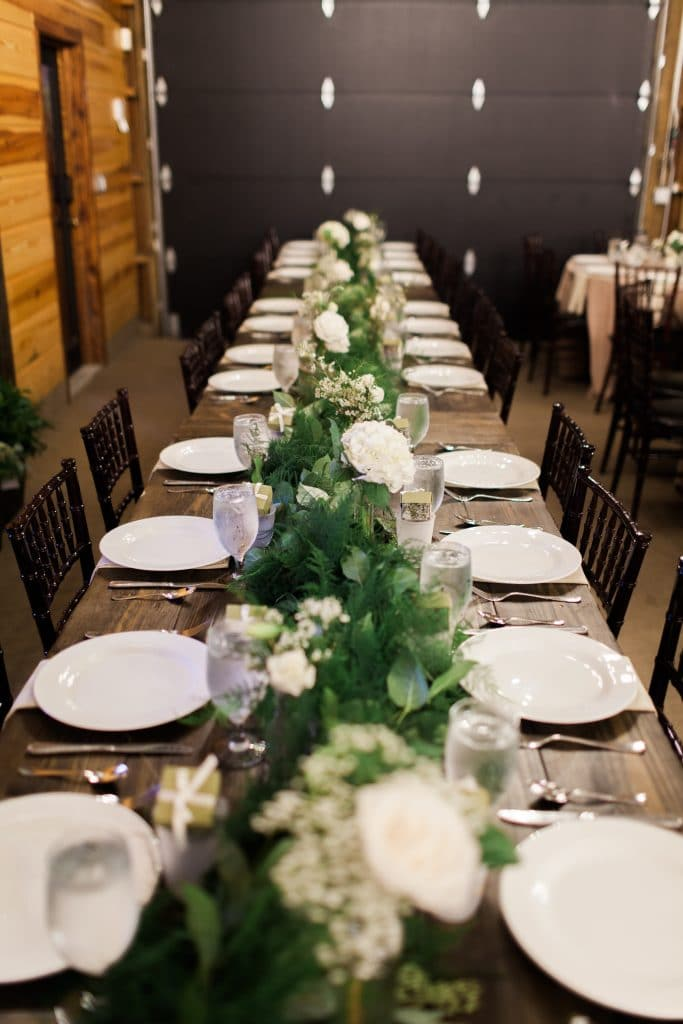 long farm table with fern garland centerpiece
