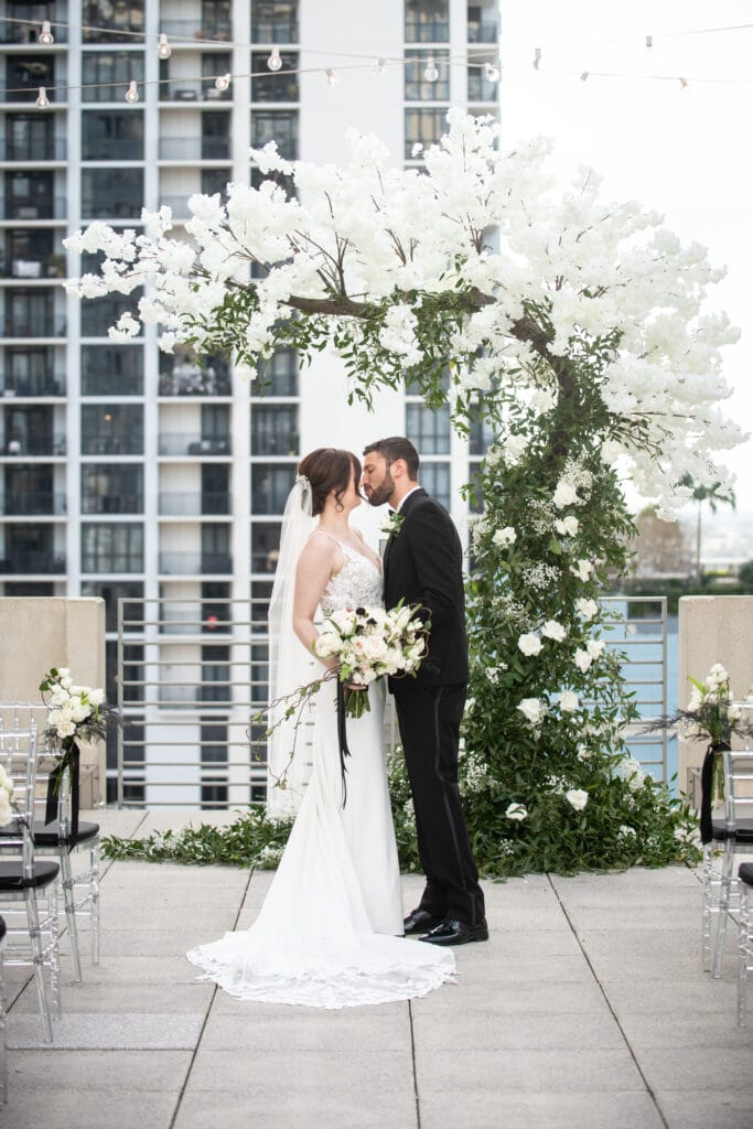 orlando wedding florist bluegrass chic white flower tree arch on the rooftop of the balcony
