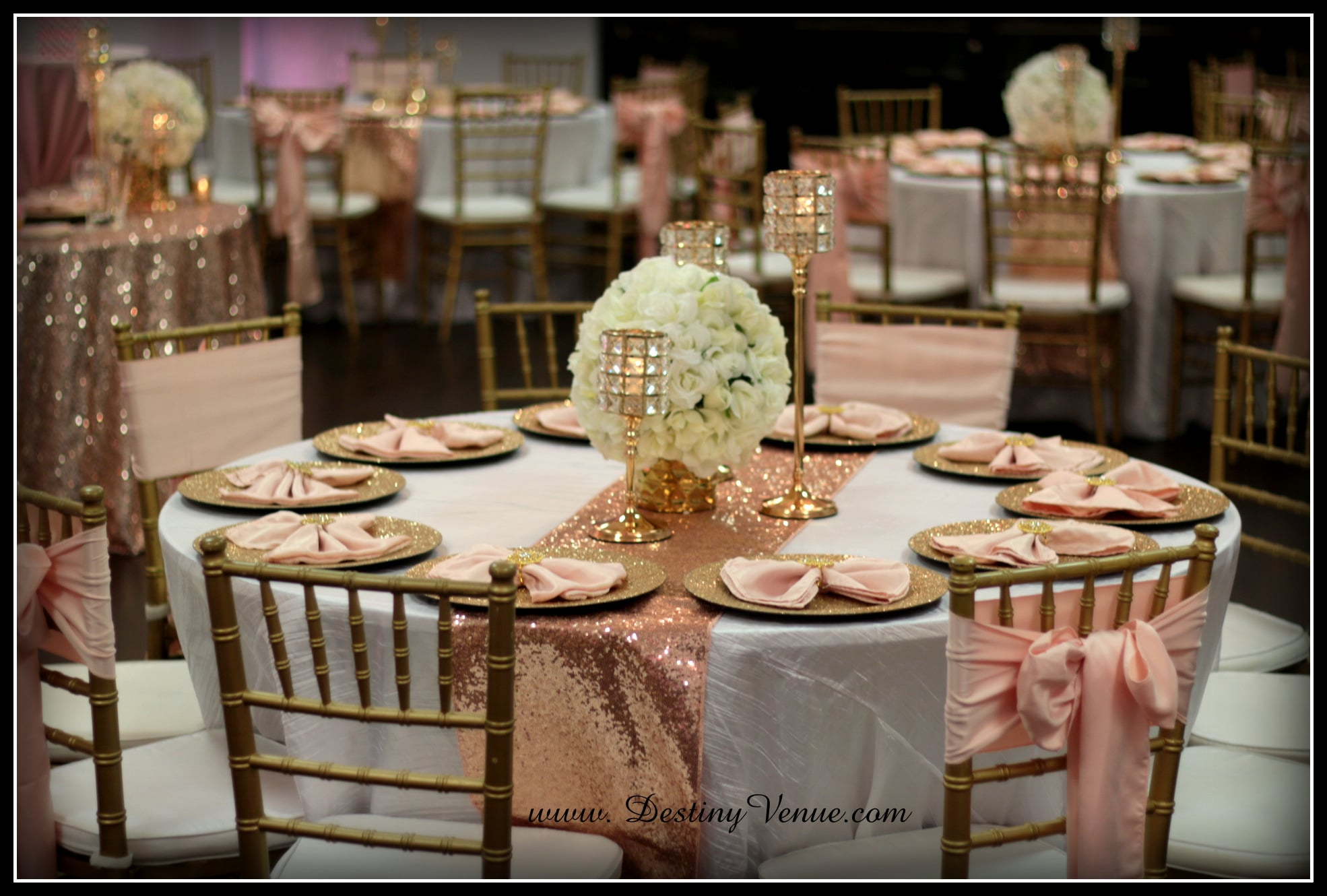 Destiny Event Venue- round white table with sparkly pink runner and gold accents