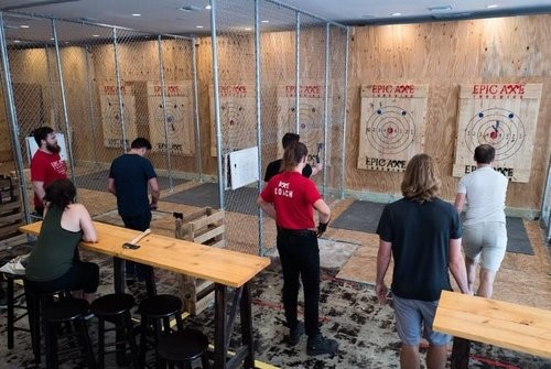 Epic-Axe-Throwing-View of people throwing axes at target boards on range