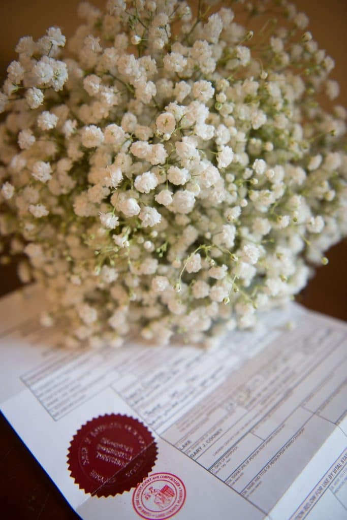 Florida-Marriage-License-Marriage license with bouquet of babys breath