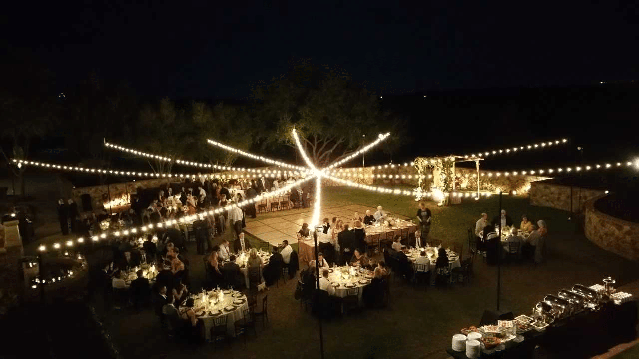 Get Lit Productions - outdoor reception strung with market lighting over dance floor