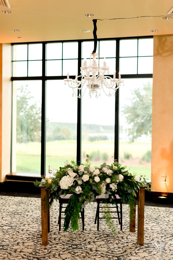 Get Lit Productions - chandelier hanging over rustic sweetheart table