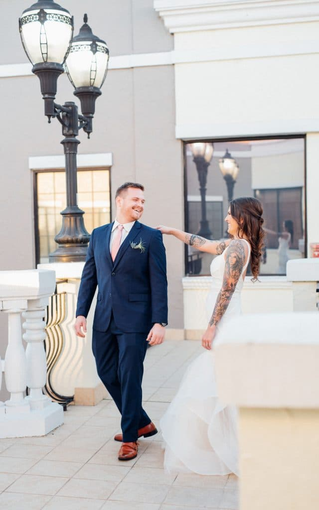 Hub 925 - tattooed bride posing with groom near beautiful lamp post