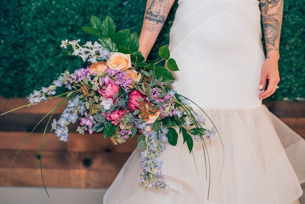 Hub 925 - tattooed bride holding loose bouquet